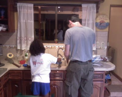 "Anna Duggan teaching Dan the finer points of dishwashing.  The Duggan family hosted Dan during his stay in Costa Rica.  Yesterday, Dan traveled by ""Ticabus"" from Costa Rica to Nicaragua with a group of about 15 Church of God pastors.  He will attend a pastor's conference in Nicaragua through Saturday."
